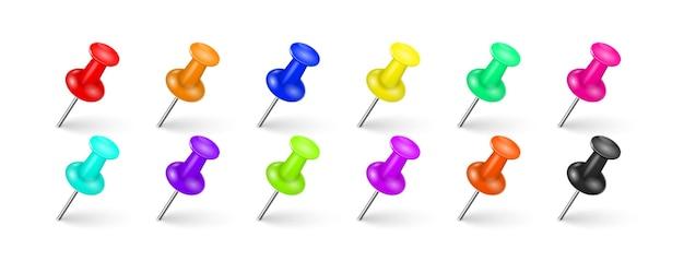 Puntine multicolori con un'ombra realistica su uno sfondo bianco