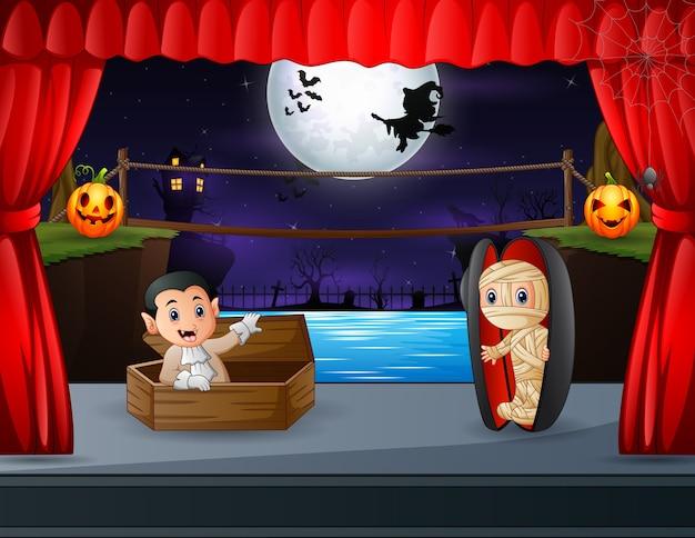 Mummia e vampiri fuori dalle bare sul palco di halloween