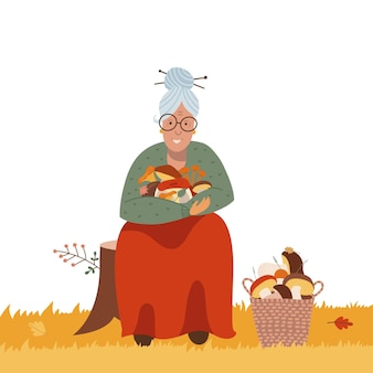 Raccolta di funghi o concetto di caccia anziana donna che trova funghi nella foresta anziani attivi anziani la...