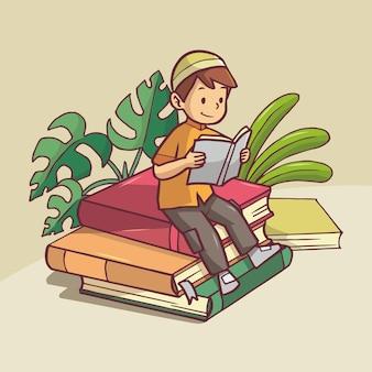 Ragazzo musulmano che indossa abiti arancioni leggendo un libro su una pila di libri