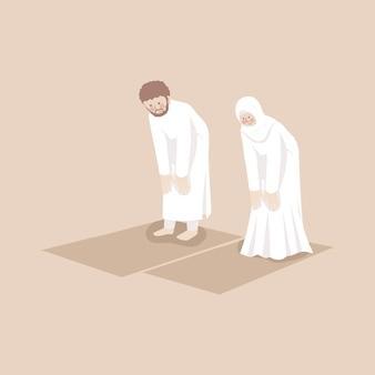 Coppia musulmana che prega insieme in posizione ruku nel tappetino da preghiera