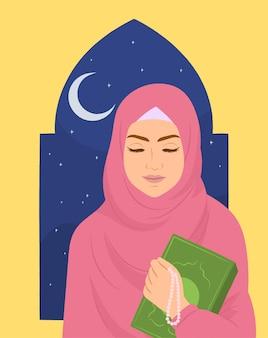 Ragazza musulmana che studia il corano