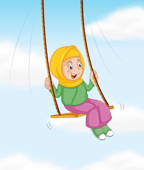 Una ragazza musulmana in altalena