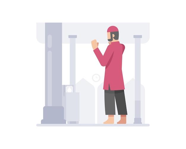 L'uomo musulmano prega in una moschea