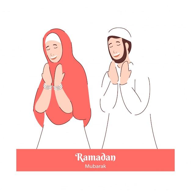 Uomo e donna musulmani che pregano in occasione di ramadan mubarak.