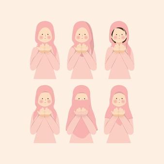 Donne musulmane che pregano dua nel set di pacchetti