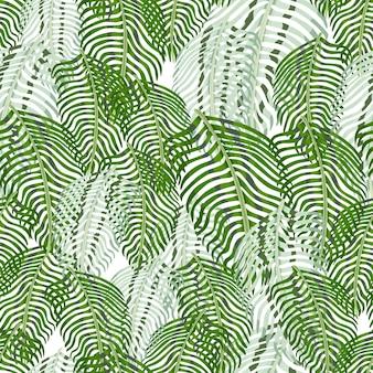 Modello senza cuciture naturale con ornamento di fogliame di sagome di felce. stampa casuale di foglie verdi e blu.