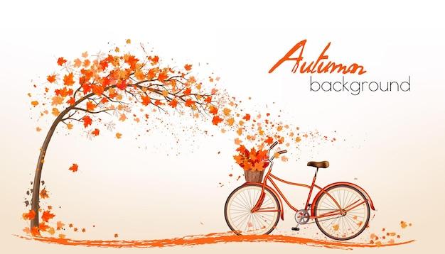 Fondo autunnale della natura con foglie colorate e una bicicletta. vettore