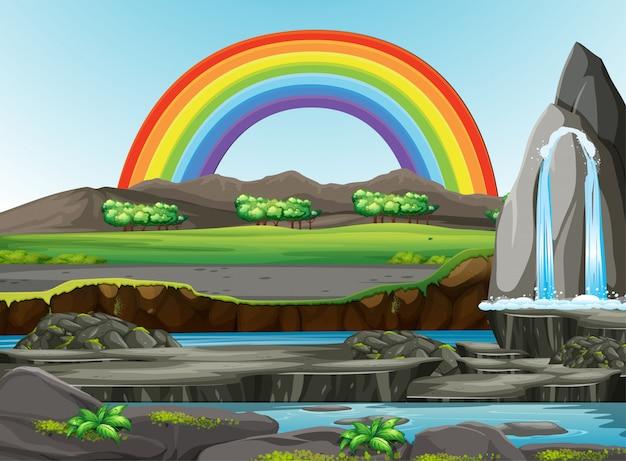 Vista della foresta della natura con l'arcobaleno nella scena del cielo