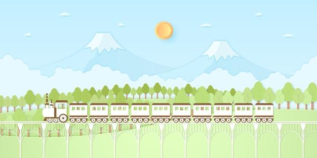 Natura collina, montagna, alberi con sole e cielo blu, trasporto, treno, stile di arte della carta