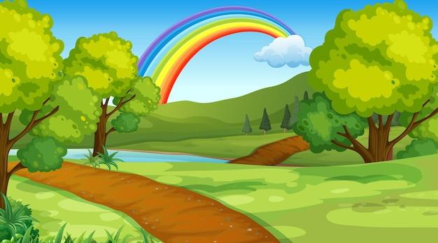 Sfondo di scena del parco naturale con arcobaleno nel cielo