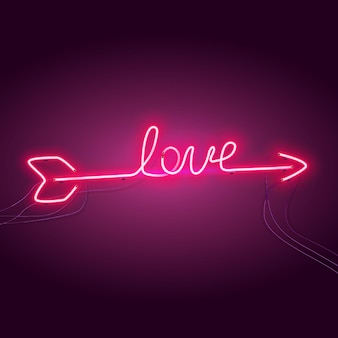 Freccia al neon a forma di scritta love.