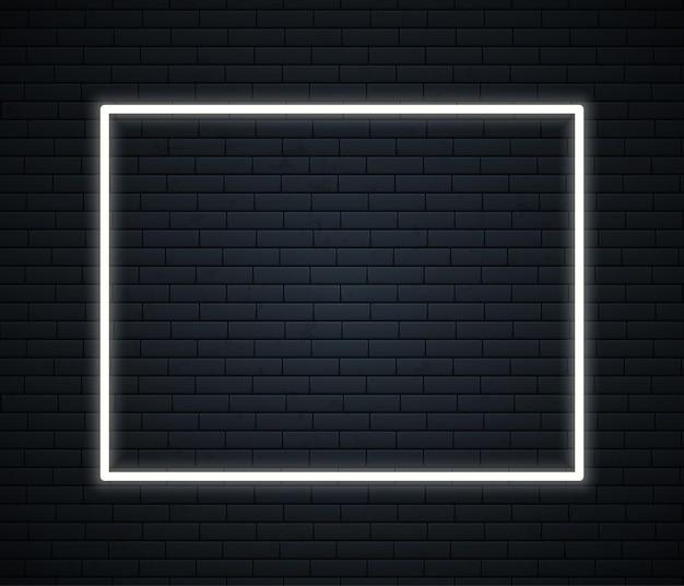 Cornice al neon con spazio per il testo sul muro di mattoni
