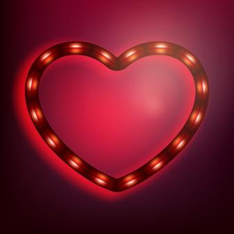 Neon incandescente cuore su sfondo rosso.