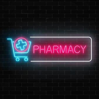 Insegna d'ardore della farmacia al neon con l'incrocio medico in carrello sul muro di mattoni