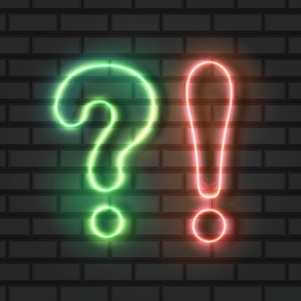 Punto interrogativo e punto esclamativo al neon luci verdi e arancioni