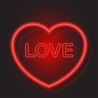 Cuore rosso al neon per san valentino su sfondo nero. Vettore Premium