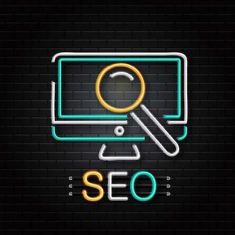 Insegna al neon del computer e lente di ingrandimento per la decorazione sullo sfondo della parete. logo al neon realistico per seo. concetto di ottimizzazione dei motori di ricerca.