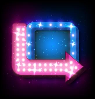 Insegna al neon con freccia e luce incandescente