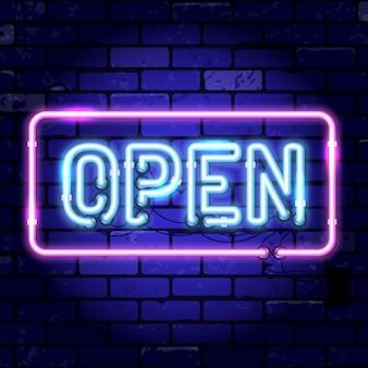 Insegna al neon con cornice aperta. insegna luminosa di notte sul segno del muro di mattoni.