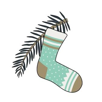 Calzino di capodanno con motivi e un ramo di albero di natale. elemento decorativo festivo per il design durante le vacanze invernali