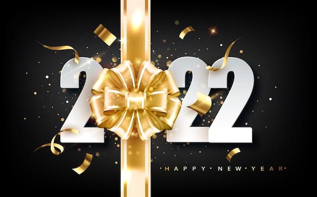 Capodanno 2022. biglietto di auguri con data e nastro su sfondo nero.