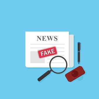 Giornale con timbro di notizie false e stazionario
