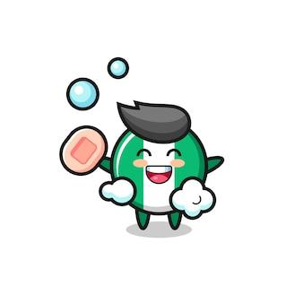 Il personaggio del distintivo della bandiera della nigeria sta facendo il bagno mentre tiene il sapone, design in stile carino per maglietta, adesivo, elemento logo
