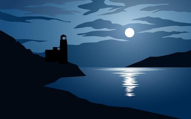 Notte in riva al mare con faro e chiaro di luna