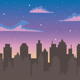 Cielo notturno stelle nuvole sagoma edifici urbani della città