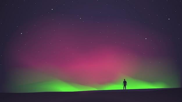 L'aurora boreale con un uomo in primo piano