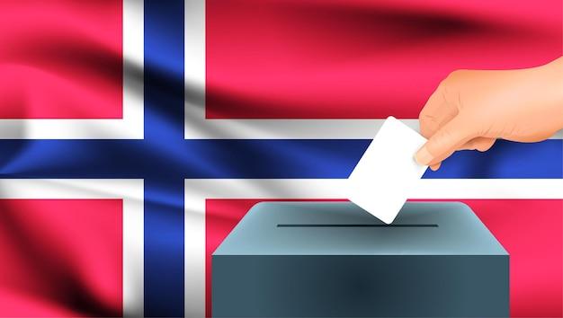 Bandiera della norvegia, voto maschio della mano con il fondo di idea di concetto della bandiera della norvegia