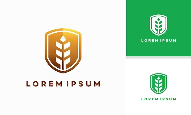 Il logo dello scudo nutrizionale progetta il vettore del concetto, lo scudo e il logo del modello di grano simbolo dell'icona