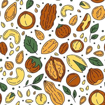 Modello senza cuciture di noci e semi in stile doodle