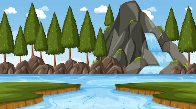 Scena di nuture con cascata nella foresta e nel fiume