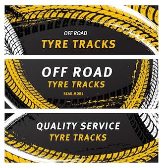 Il pneumatico fuoristrada traccia le stampe di pneumatici grunge neri per il servizio automobilistico.