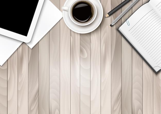 Area di lavoro dell'ufficio: caffè, tablet, carta e alcune penne.