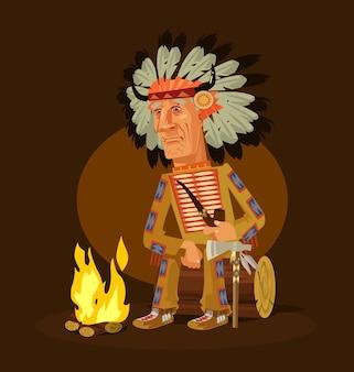Il vecchio carattere capo indiano americano seduto vicino al camino