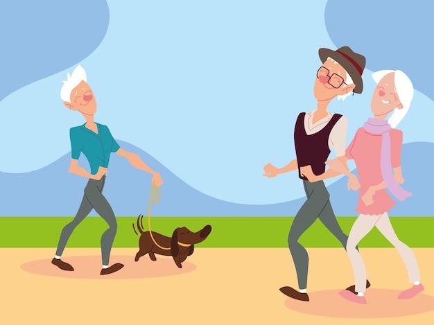 Vecchia coppia che cammina e il vecchio cammina con un cane nella progettazione del parco