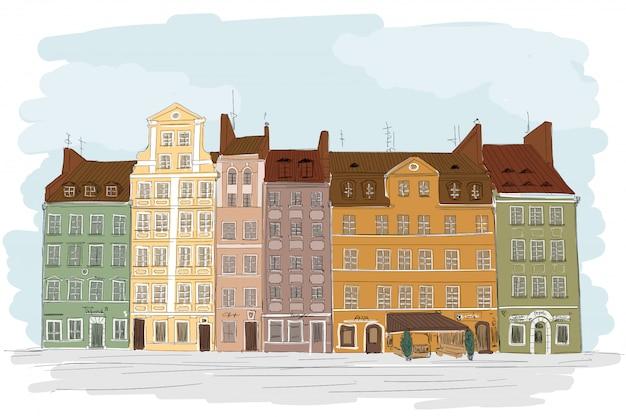 Una vecchia città europea con colorati edifici a più piani. molte finestre si affacciano sulla strada.