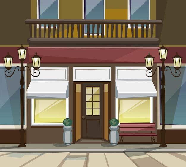 Old europian shop boutique museum restaurant cafe store front con grandi finestre, posto per nome, vegetazione, lanterne stradali e pietre per pavimentazione