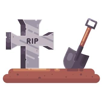 Vecchia tomba con una croce e una pala