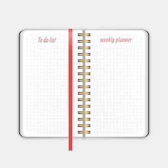 Il vecchio taccuino con agenda settimanale segnalibro ed elenco per modelli di note