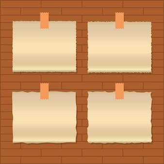 Vecchia carta isolata sul fondo del muro di mattoni