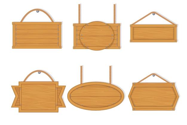 Tavole di legno vuote del vecchio ovest. tavole di legno vuote con chiodi per striscioni o messaggi appesi su catene o corde. segno d'attaccatura reale della plancia di legno su un fondo bianco.