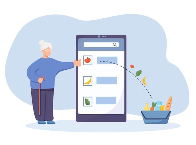 L'anziana acquista prodotti alimentari online tramite smartphone nell'applicazione. un modo più semplice di fare acquisti senza borse pesanti alla consegna.