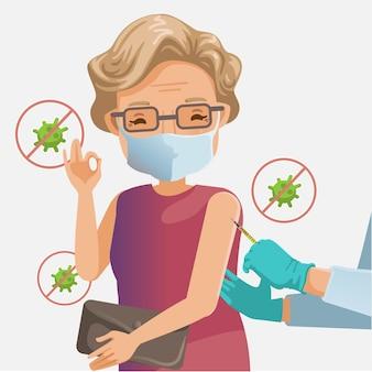 Maschera da vecchia donna vaccinata. la mano tiene una femmina anziana di vaccinazione. assistenza agli anziani del medico presso una casa di cura. concetto di vaccinazione per covid-19.