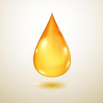 Una grande goccia d'acqua traslucida realistica nei colori gialli con ombra