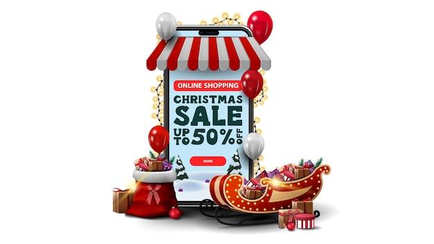 Shopping online, saldi di natale, fino al 50% di sconto. acquisti online con smartphone. smartphone volumetrico avvolto con ghirlanda e regali intorno isolato su sfondo bianco