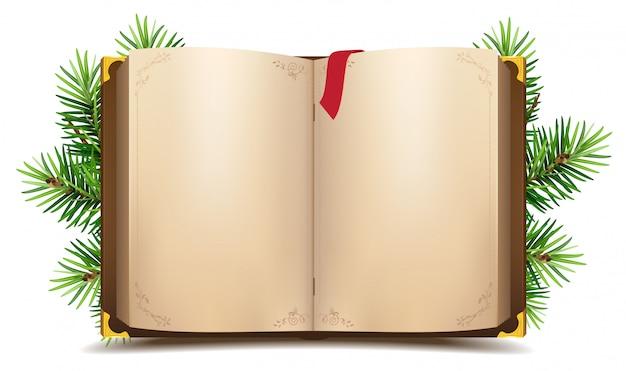 Libro aperto con pagine bianche e segnalibro rosso. ramo di pino verde di natale